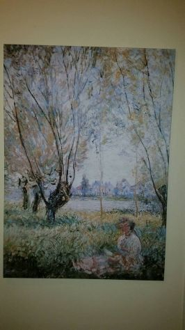 Woman seated under the willows di Claude Monet