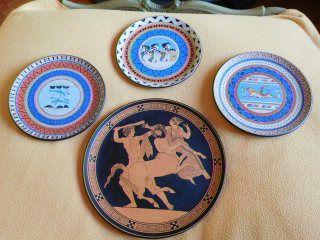 Piatti vintage anni '60 in ceramica dipinta a punta di pennello