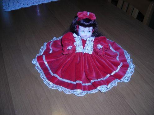 Bambola elegante per arredamento tenuta come nuova