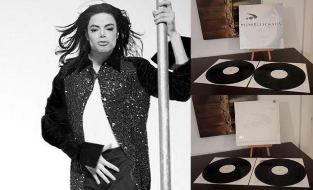 MICHAEL JACKSON, INVINCIBLE,  (ALBUM)  DOPPIO LP, 2001 TRADEMARK.