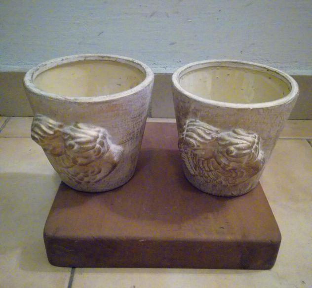 Vasetti con putti altezza cm 11 diametro 12